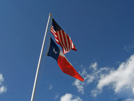 image of the american and texas state flags